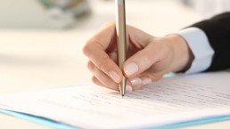 A picture depicting a person filling a form